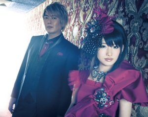 fripside in the key visual for their previous single, Black Bullet, comprising Male composer Satoshi Yaginuma and female vocalist Yoshino Nanjo