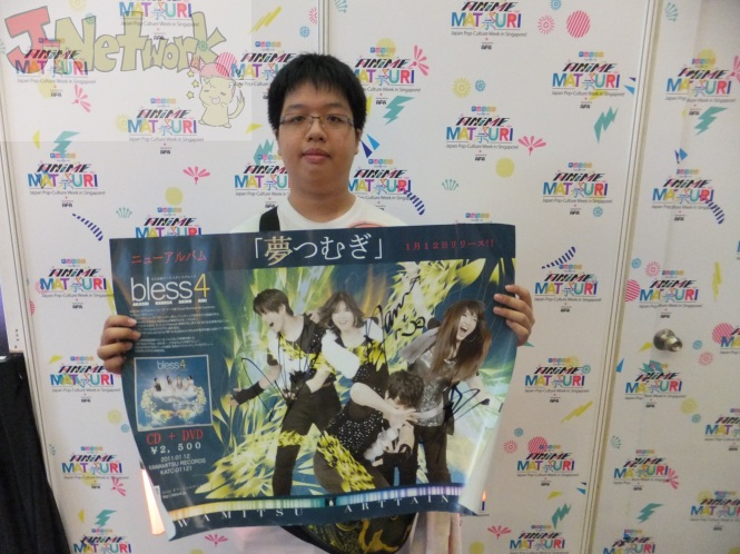 A fan, Renny, holds up his signed poster